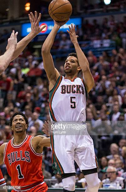 Guard Derrick Rose of the Chicago Bulls looks on as Michael CarterWilliams of the Milwaukee Bucks shoots the ball in the first quarter of game four...