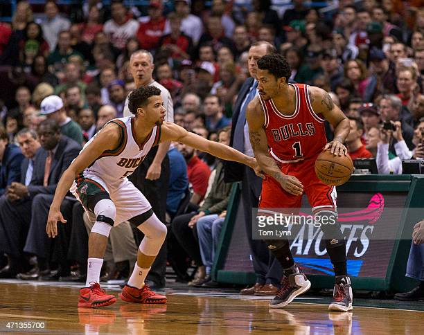 Guard Derrick Rose of the Chicago Bulls looks to make a move on guard Michael CarterWilliams of the Milwaukee Bucks in the first quarter of game four...