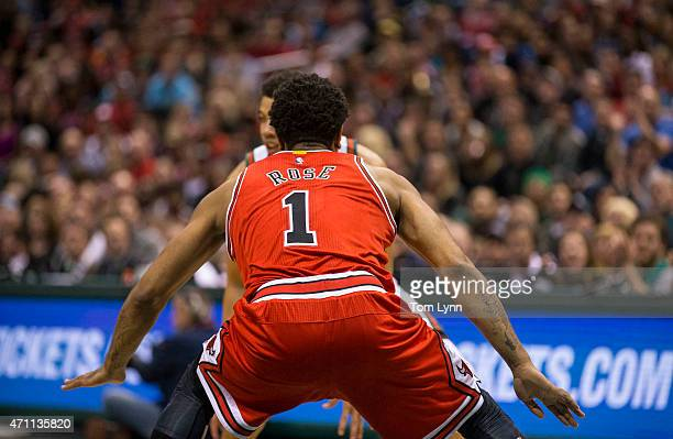 Guard Derrick Rose of the Chicago Bulls plays defense as guard Michael CarterWilliams of the Milwaukee Bucks looks to drive in the first quarter of...