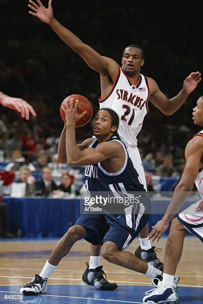 Guard Derrick Snowden of the Villanova Wildcats looks to pass while being pressured by guard DeShaun Williams of the Syracuse Orangemen during the...