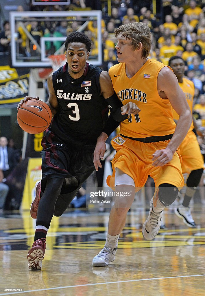 Guard Desmar Jackson #3 of the Southern Illinois Salukis drives up court against pressure from guard Ron Baker #31 of the Wichita State Shockers during the first half on February 11, 2014 at Charles Koch Arena in Wichita, Kansas. Wichita State won 78-67.
