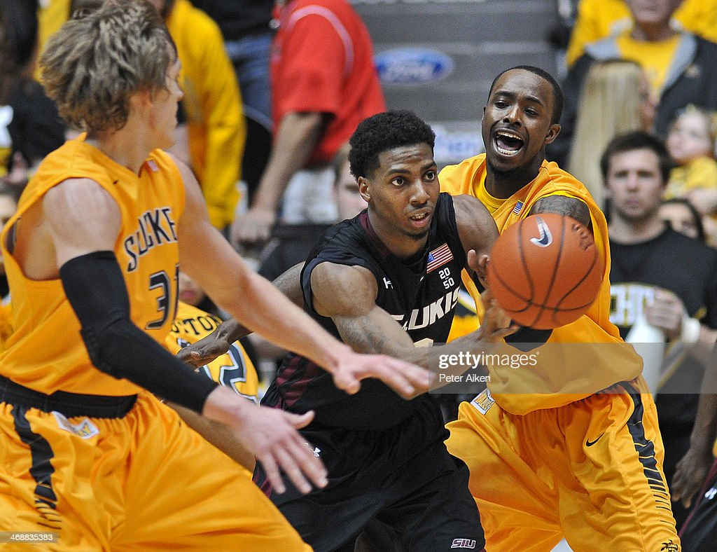 Guard Desmar Jackson #3 of the Southern Illinois Salukis makes a pass against pressure from guard Nick Wiggins #25 of the Wichita State Shockers during the first half on February 11, 2014 at Charles Koch Arena in Wichita, Kansas. Wichita State won 78-67.