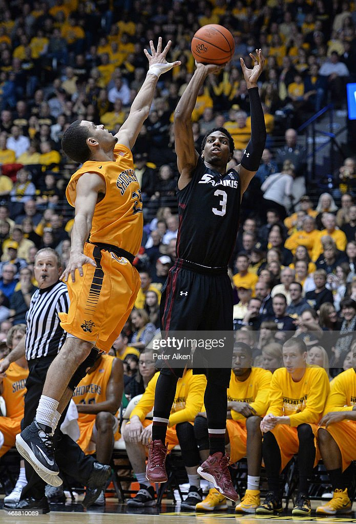 Guard Desmar Jackson #3 of the Southern Illinois Salukis shoots over guard Fred VanVleet #23 of the Wichita State Shockers during the first half on February 11, 2014 at Charles Koch Arena in Wichita, Kansas.