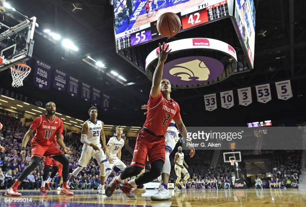 Guard Devon Thomas of the Texas Tech Red Raiders reaches for a loose ball against the Kansas State Wildcats during the second half on March 4 2017 at...