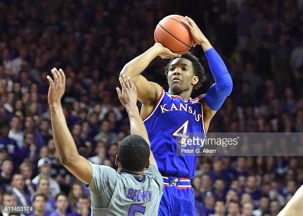 Guard Devonte Graham of the Kansas Jayhawks shoots the ball over guard Barry Brown of the Kansas State Wildcats during the first half on February 20...