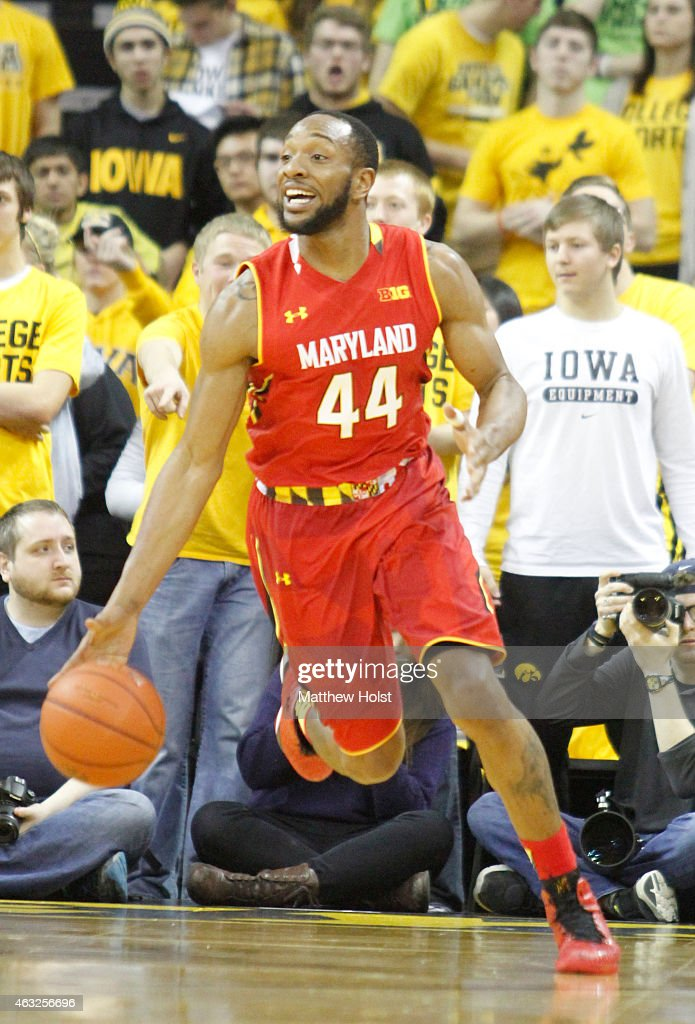 Guard Dez Wells of the Maryland Terrapins brings the ball down the court in the first half against the Iowa Hawkeyes at CarverHawkeye Arena on...