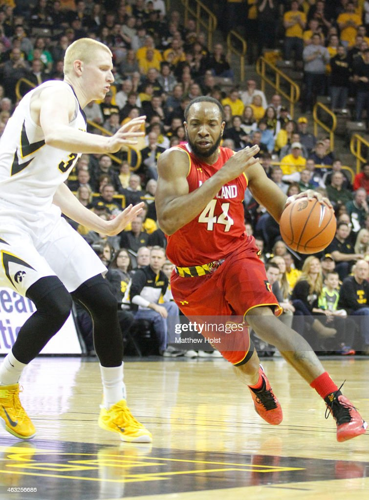 Guard <a gi-track='captionPersonalityLinkClicked' href=/galleries/search?phrase=Dez+Wells&family=editorial&specificpeople=9960403 ng-click='$event.stopPropagation()'>Dez Wells</a> #44 of the Maryland Terrapins drives to the basket against forward <a gi-track='captionPersonalityLinkClicked' href=/galleries/search?phrase=Aaron+White+-+Basketball+Player&family=editorial&specificpeople=14619648 ng-click='$event.stopPropagation()'>Aaron White</a> #20 of the Iowa Hawkeyes in the first half at Carver-Hawkeye Arena on February 8, 2015 in Iowa City, Iowa.