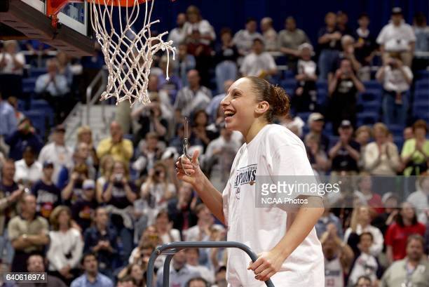 UCONN guard Diana Taurasi is all smiles as she prepares to cut down the net after defeating the University of Oklahoma following the Division 1...