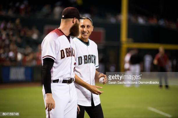 WNBA guard Diana Taurasi of the Phoenix Mercury throws out the ceremonial first pitch prior to a game against the Arizona Diamondbacks and St Louis...