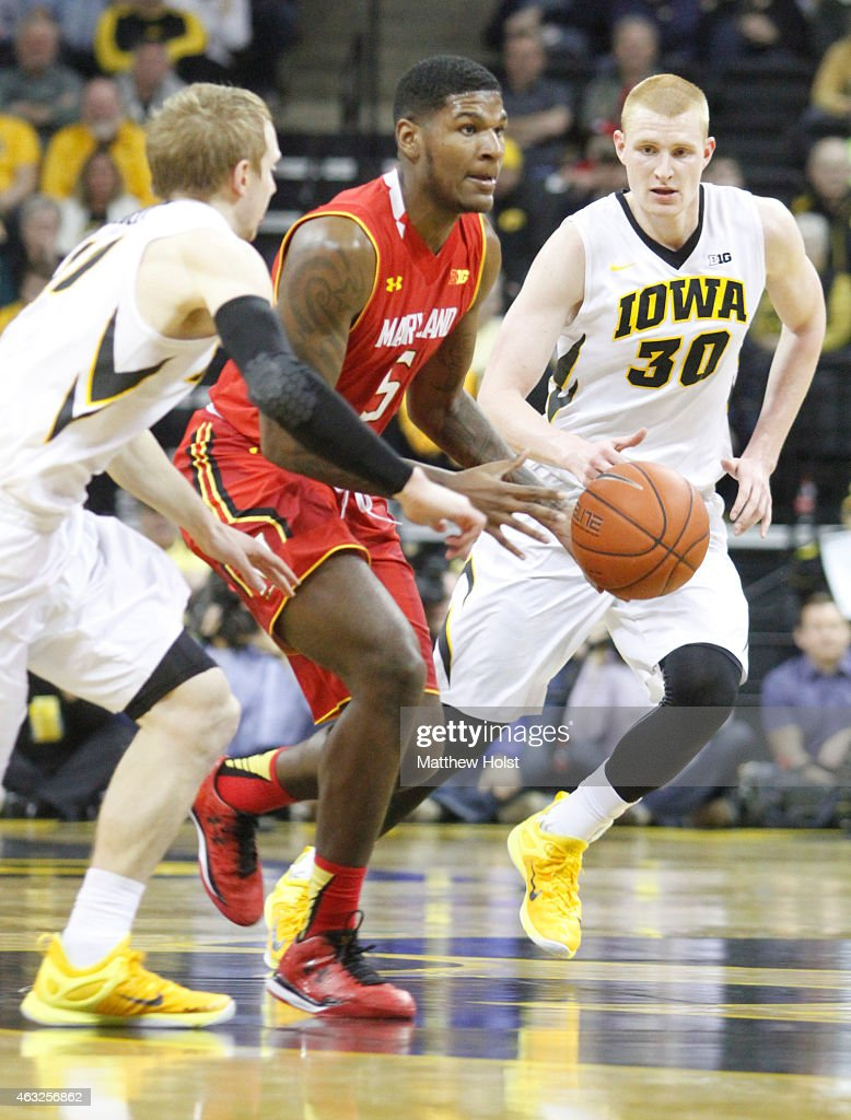 Guard Dion Wiley #5 of the Maryland Terrapins brings the ball down the court between forward <a gi-track='captionPersonalityLinkClicked' href=/galleries/search?phrase=Aaron+White+-+Basketball+Player&family=editorial&specificpeople=14619648 ng-click='$event.stopPropagation()'>Aaron White</a> #30 and guard Mike Gesell #10 of the Iowa Hawkeyes in the second half at Carver-Hawkeye Arena on February 8, 2015 in Iowa City, Iowa.