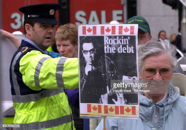 A Guard directs protesters in a march in Dublin which ended outside the Canadian Embassy where a petition was delivered to the Ambassador urging his...