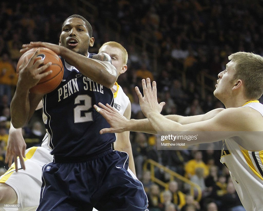 Guard D.J. Newbill of the Penn State Nittany Lions grabs a rebound during the first half in front of guard Josh Oglesby #2 and forward Aaron White #30 of the Iowa Hawkeyes on January 31, 2013 at Carver-Hawkeye Arena in Iowa City, Iowa.