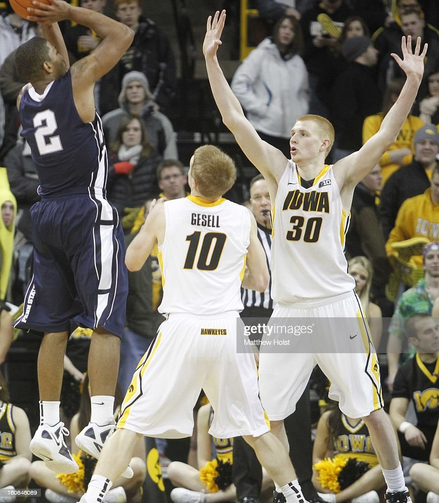 Guard D.J. Newbill of the Penn State Nittany Lionstakes a shot during the second half in front of forward Aaron White #30 and guard Mike Gesell #10 of the Iowa Hawkeyes on January 31, 2013 at Carver-Hawkeye Arena in Iowa City, Iowa. Iowa won 76-67.