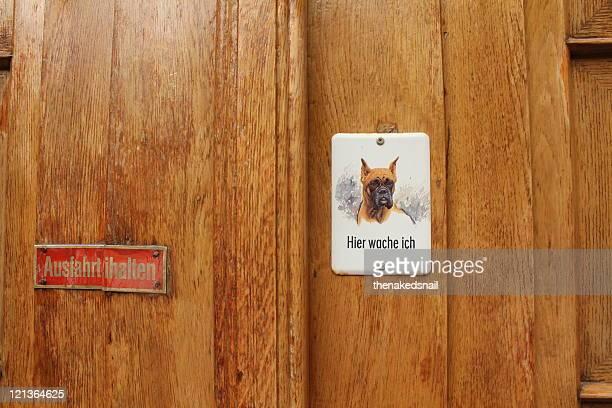 Guard dog warning on wooden door
