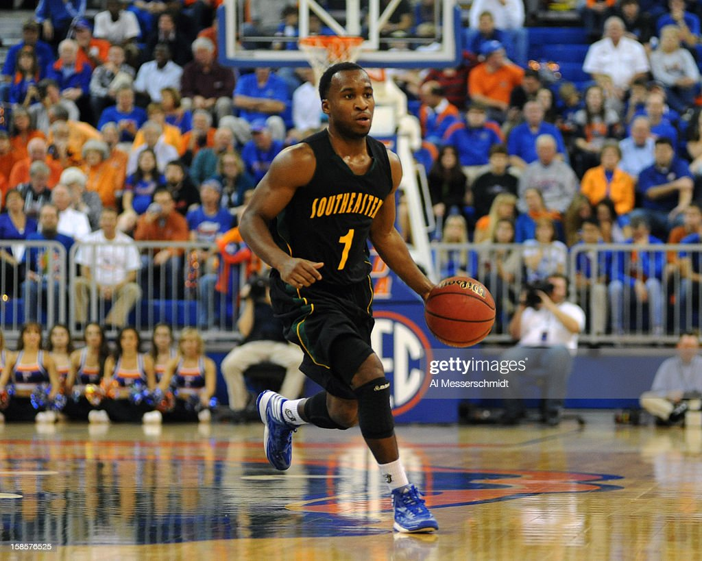 Guard Dre Evans #1 of the Southeastern Louisiana Lions drives up court against the Florida Gators December 19, 2012 at Stephen C. O'Connell Center in Gainesville, Florida. Florida won 82 - 43.