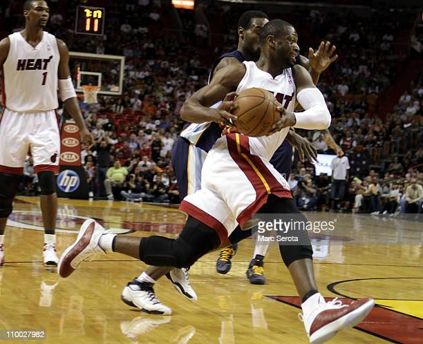 Guard Dwyane Wade of the Miami Heat drives against the Memphis Grizzlies at American Airlines Arena on March 12 2011 in Miami Florida NOTE TO USER...