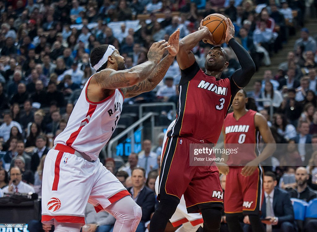 Guard Dwayne Wade of the Miami Heat lines up a shot as forward James Johnson of the Toronto Raptors moves to block in the first quarter at Air Canada...