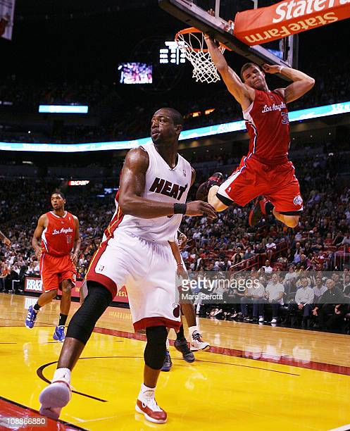 Guard Dwyane Wade of the Miami Heat passes against guard Forward Blake Griffin of the LA Clippers at American Airlines Arena on February 6 2011 in...