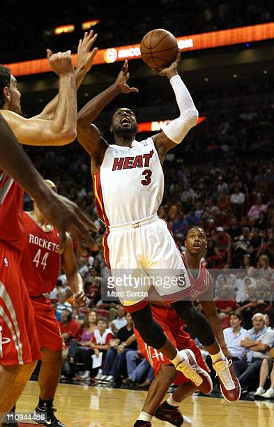 Guard Dwyane Wade of the Miami Heat shoots against the Houston Rockets at American Airlines Arena on March 27 2011 in Miami Florida NOTE TO USER User...