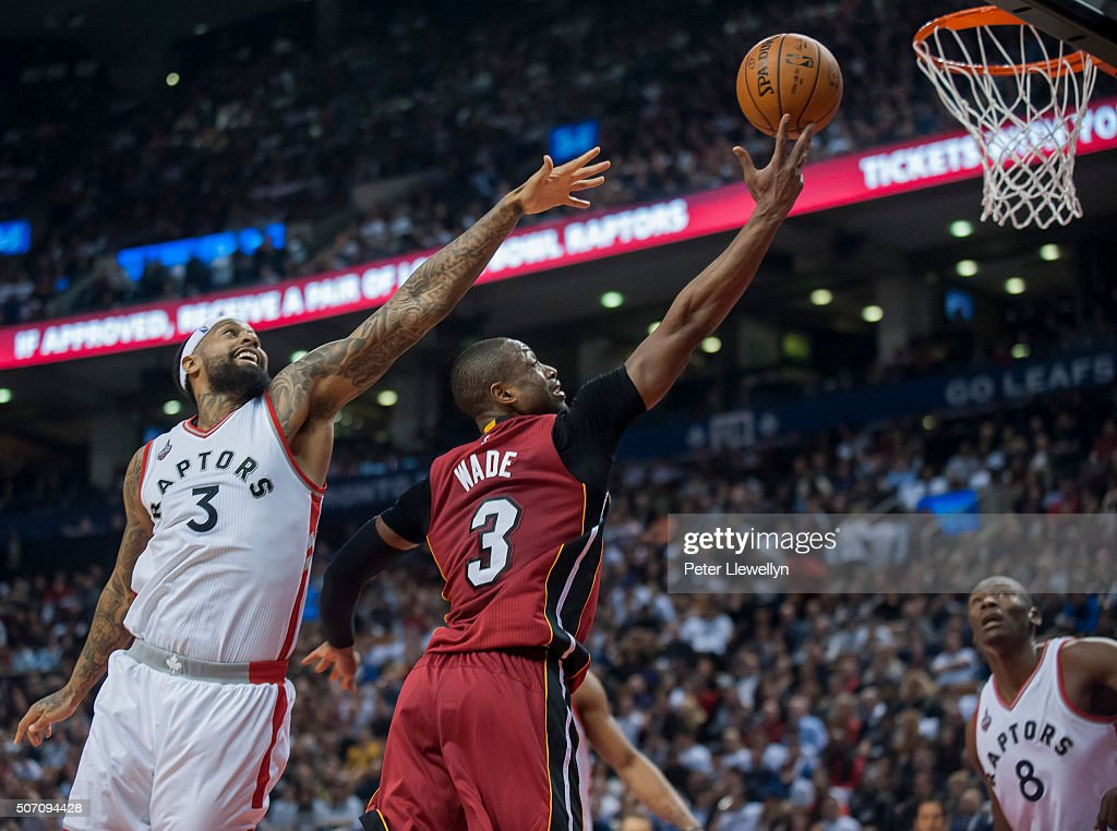Guard Dwayne Wade of the Miami Heat shoots as forward James Johnson of the Toronto Raptors attempts to block in the second quarter at Air Canada...
