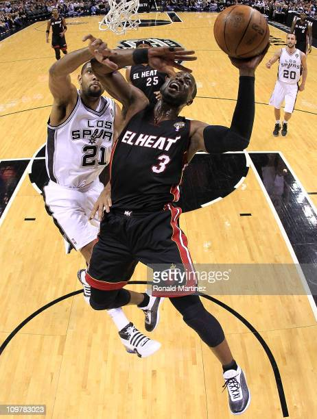 Guard Dwyane Wade of the Miami Heat takes a shot against Tim Duncan of the San Antonio Spurs at ATT Center on March 4 2011 in San Antonio Texas NOTE...