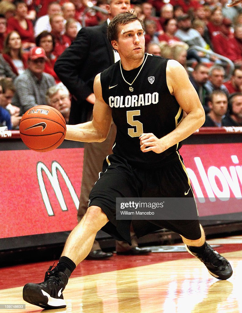 Guard Eli Stalzer#5 of the Colorado Buffaloes controls the ball during the second half of the game against the Washington State Cougars at Beasley Coliseum on January 19, 2013 in Pullman, Washington.