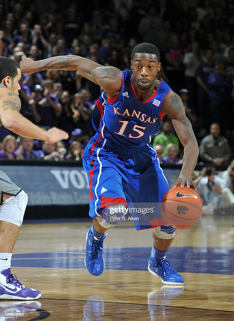 Guard Elijah Johnson #15 of the Kansas Jayhawks drives up court against the Kansas State Wildcats during the first half on January 22, 2013 at Bramlage Coliseum in Manhattan, Kansas. Kansas defeated Kansas State 59-55.