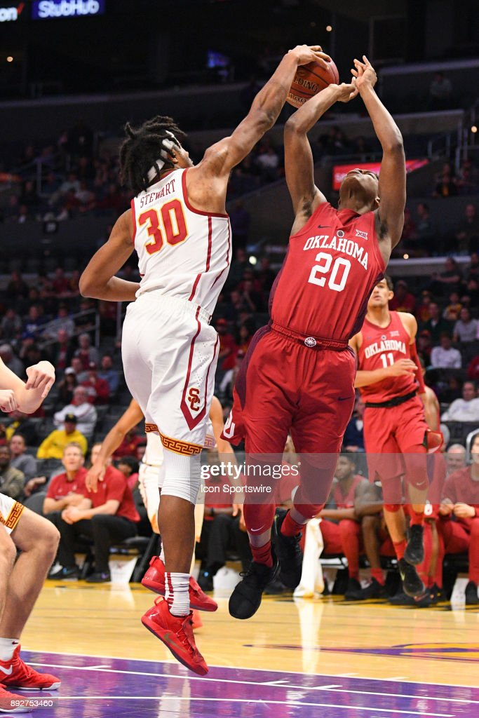USC guard Elijah Stewart (30) blocks Oklahoma guard Kameron McGusty (20) shot during an college basketball game between the Oklahoma Sooners and the USC Trojans in the Basketball Hall of Fame Classic on December 8, 2017 at STAPLES Center in Los Angeles, CA.