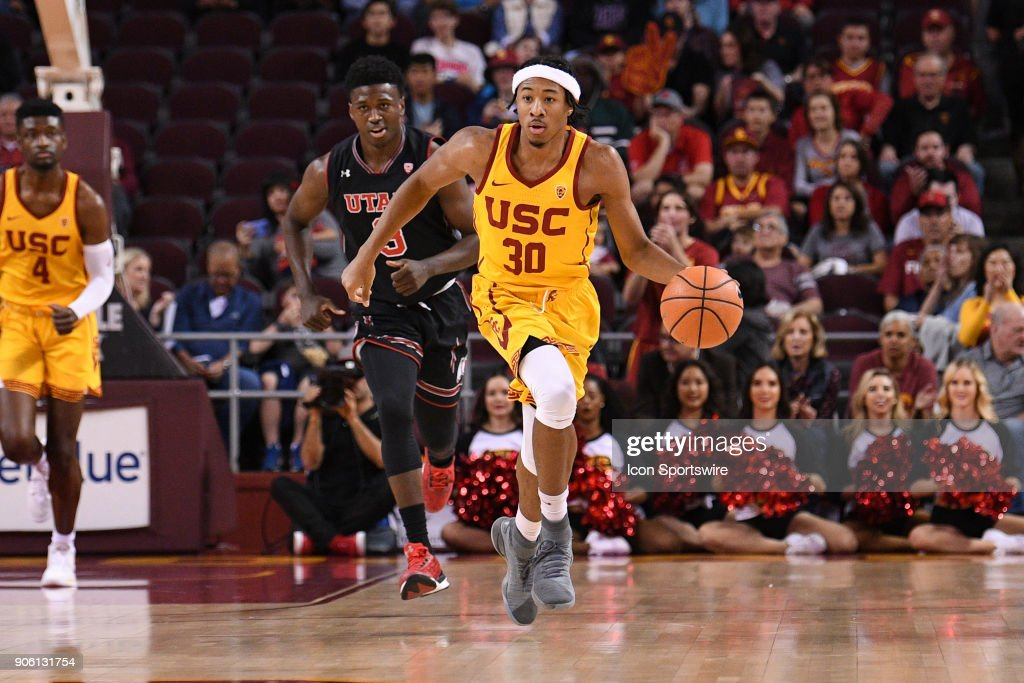 USC guard Elijah Stewart (30) brings the ball up the court during a college basketball game between the Utah Utes and the USC Trojans on January 14, 2018, at the Galen Center in Los Angeles, CA.