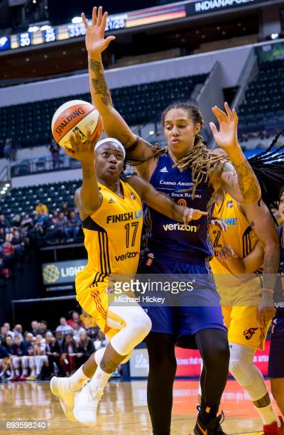 Guard Erica Wheeler of the Indiana Fever shoots the ball against center Brittney Griner of the Phoenix Mercury at Bankers Life Fieldhouse on June 7...