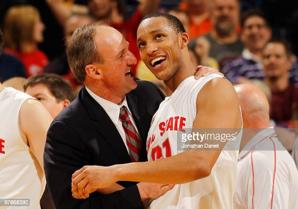 Guard Evan Turner of the Ohio State Buckeyes celebrates with head coach Thad Matta after making a game winning three point basket in their...
