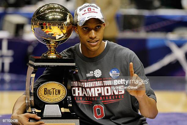 Guard Evan Turner of the Ohio State Buckeyes celebrates with the Big Ten tournament championship trophy after winning the Big Ten Men's Basketball...