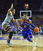 Guard Frank Mason III of the Kansas Jayhawks drives to the basket against guard Barry Brown of the Kansas State Wildcats during the first half on...
