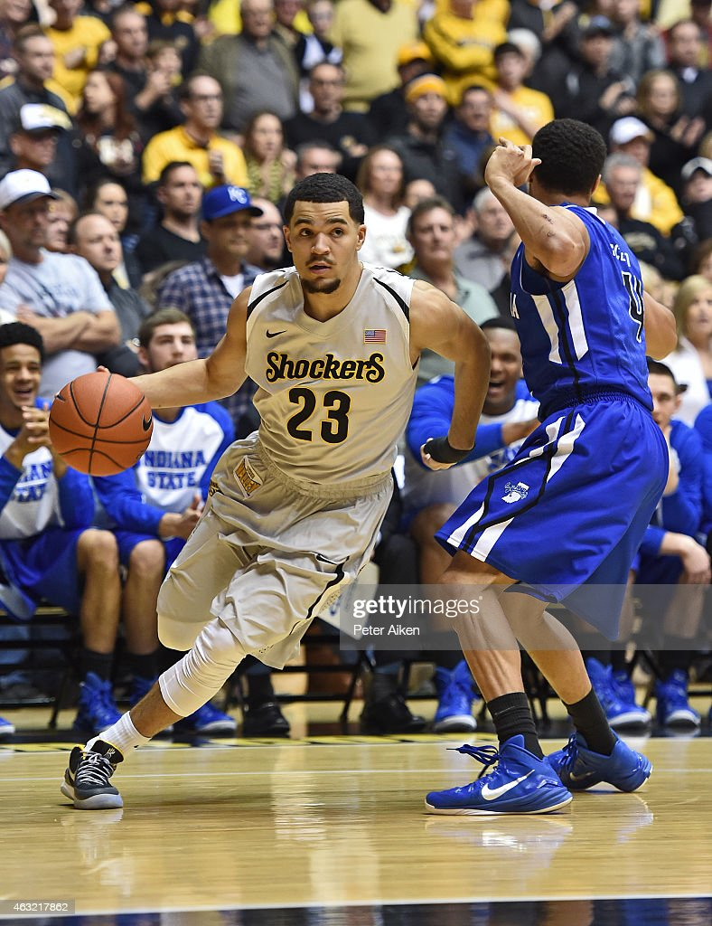 Guard <a gi-track='captionPersonalityLinkClicked' href=/galleries/search?phrase=Fred+VanVleet&family=editorial&specificpeople=10612238 ng-click='$event.stopPropagation()'>Fred VanVleet</a> #23 of the Wichita State Shockers drives past guard Brenton Scott #4 of the Indiana State Sycamores during the first half on February 11, 2015 at Charles Koch Arena in Wichita, Kansas.