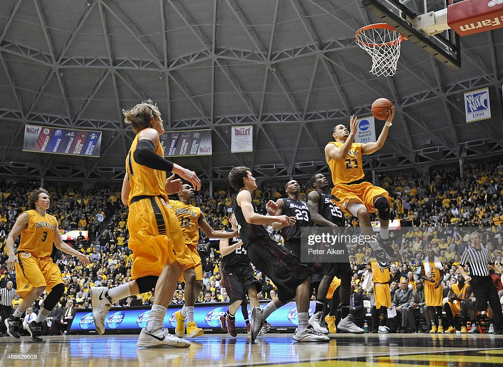 Guard Fred VanVleet #23 of the Wichita State Shockers drives to the basket for a score past guard Anthnoy Beane #25 of the Southern Illinois Salukis during the second half on February 11, 2014 at Charles Koch Arena in Wichita, Kansas. Wichita State won 78-67.