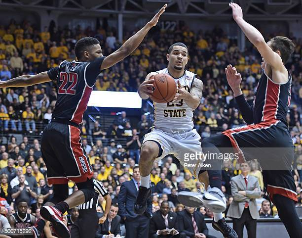 Guard Fred VanVleet of the Wichita State Shockers drives with the ball against defenders Stephen Zimmerman Jr #33 and Patrick McCaw of the UNLV...