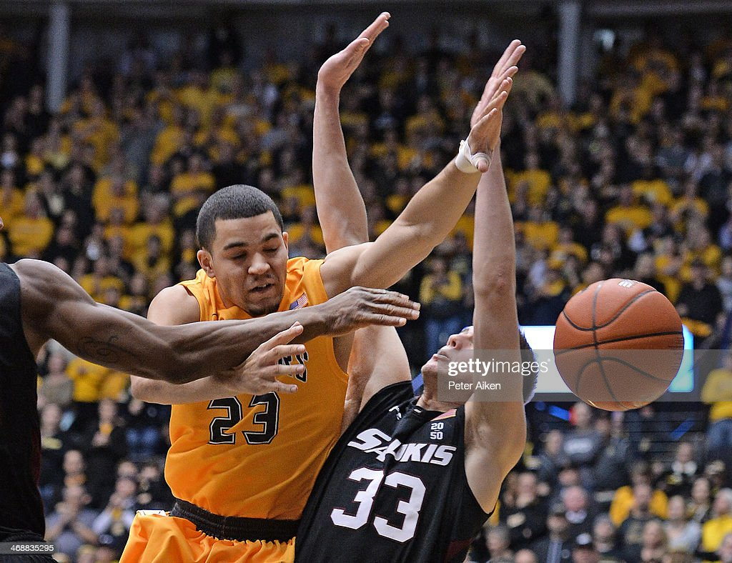 Guard Fred VanVleet #23 of the Wichita State Shockers is fouled driving to the basket by forward Sean O'Brien #33 of the Southern Illinois Salukis during the second half on February 11, 2014 at Charles Koch Arena in Wichita, Kansas. Wichita State won 78-67.