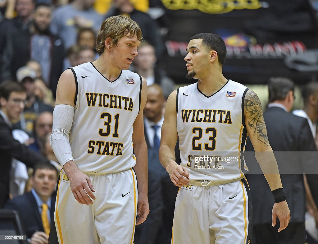 Guard Fred VanVleet #23 of the Wichita State Shockers talks with teammate Ron Baker #31 during the second half against the Evansville Aces on January 6, 2016 at Charles Koch Arena in Wichita, Kansas. Wichita State defeated Evansville 67-64.