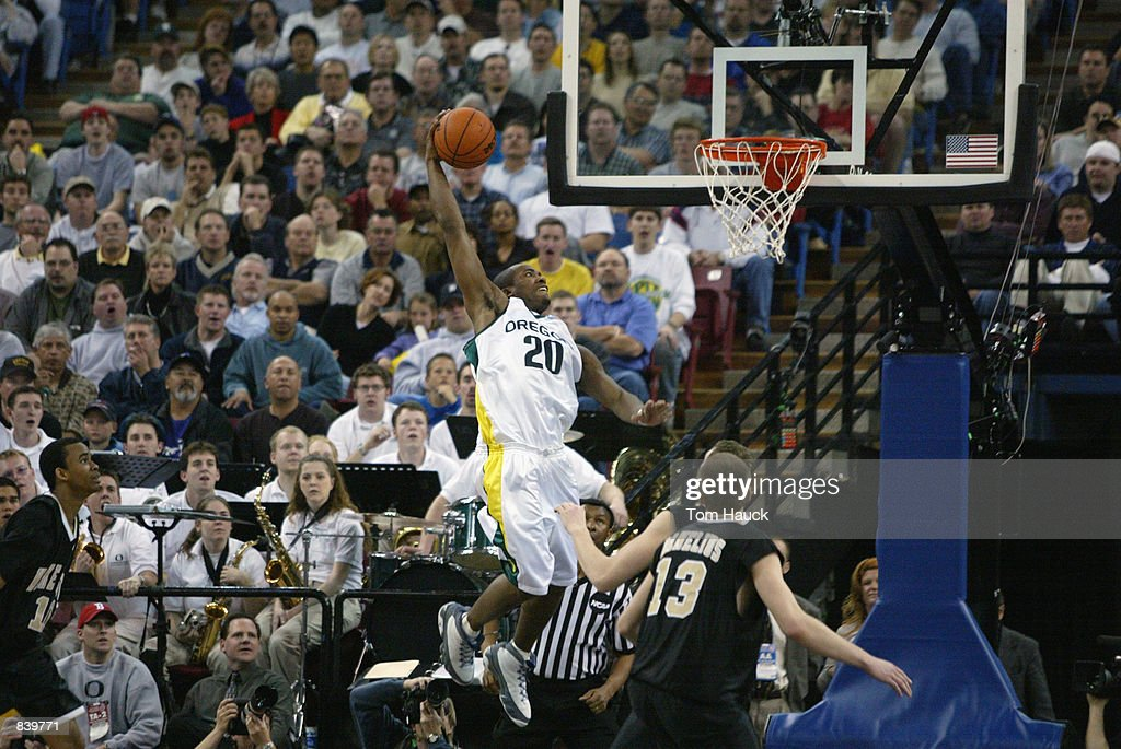 Guard Frederick Jones of the Oregon Ducks goes for the right hand slam dunk against the Wake Forest Demon Deacons during the second round of the 2002...