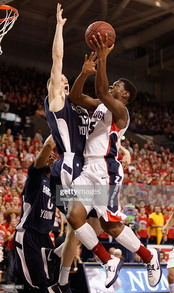 Guard Gary Bell Jr. #5 of the Gonzaga Bulldogs goes up for a goal against forward Josh Sharp #12 of the BYU Cougars during the game at McCarthey Athletic Center on January 24, 2013 in Spokane, Washington.