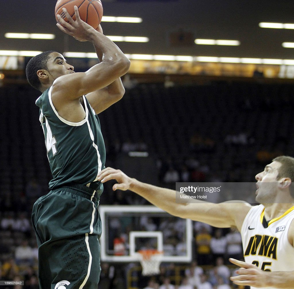 Guard Gary Harris #14 of the Michigan State Spartans takes a shot during the first half in front of forward Eric May #25 of the Iowa Hawkeyes on January 10, 2013 at Carver-Hawkeye Arena in Iowa City, Iowa. Michigan State won 62-59.