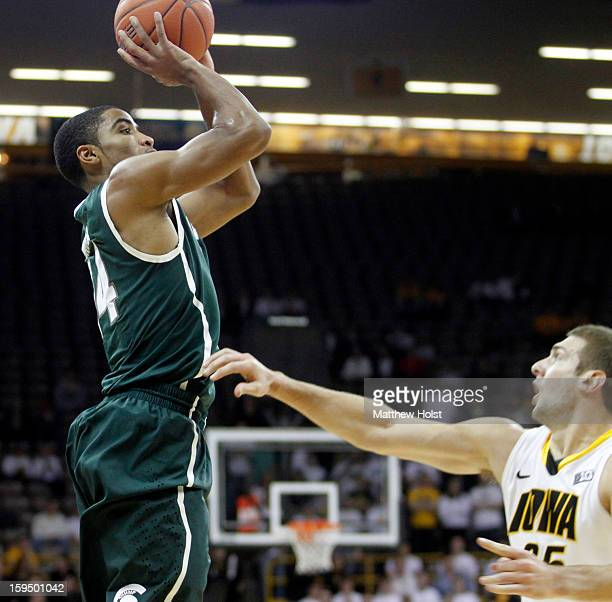 Guard Gary Harris of the Michigan State Spartans takes a shot during the first half in front of forward Eric May of the Iowa Hawkeyes on January 10...