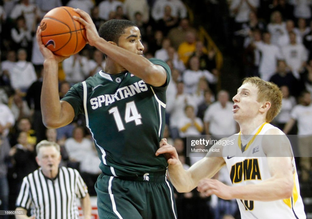 Guard Gary Harris #14 of the Michigan State Spartans works down the court during the second half against guard Mike Gesell #10 of the Iowa Hawkeyes on January 10, 2013 at Carver-Hawkeye Arena in Iowa City, Iowa. Michigan State won 62-59.