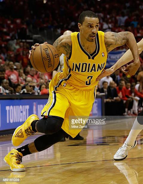 Guard George Hill of the Indiana Pacers dribbles in Game Six of the Eastern Conference Quarterfinals against the Atlanta Hawks during the 2014 NBA...
