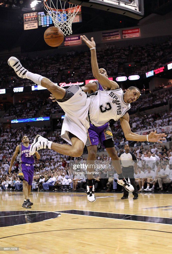 Guard <a gi-track='captionPersonalityLinkClicked' href=/galleries/search?phrase=George+Hill+-+Basketball+Player&family=editorial&specificpeople=6831399 ng-click='$event.stopPropagation()'>George Hill</a> #3 of the San Antonio Spurs is fouled by <a gi-track='captionPersonalityLinkClicked' href=/galleries/search?phrase=Channing+Frye&family=editorial&specificpeople=206815 ng-click='$event.stopPropagation()'>Channing Frye</a> #8 of the Phoenix Suns in Game Three of the Western Conference Semifinals during the 2010 NBA Playoffs at AT&T Center on May 7, 2010 in San Antonio, Texas.