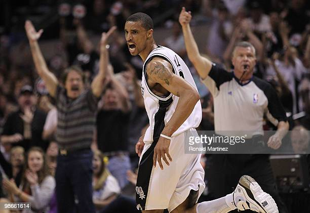 Guard George Hill of the San Antonio Spurs reacts after scoring at the end of the first quarter against the Dallas Mavericks in Game Four of the...