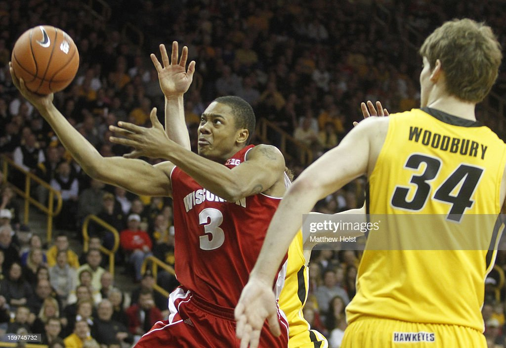 Guard George Marshall #3 of the Wisconsin Badgers drives to the basket during the first half between guard Mike Gesell #10 and center Adam Woodbury #34 of the Iowa Hawkeyes on January 19, 2013 at Carver-Hawkeye Arena in Iowa City, Iowa. Iowa won 70-66.