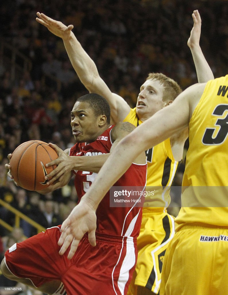 Guard George Marshall #3 of the Wisconsin Badgers drives to the basket during the first half against guard Mike Gesell #10 of the Iowa Hawkeyes on January 19, 2013 at Carver-Hawkeye Arena in Iowa City, Iowa.