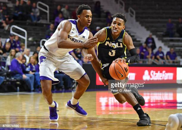 Guard Gino Littles of the Northern Arizona Lumberjacks drives against guard Brian Patrick of the Kansas State Wildcats during the first half on...