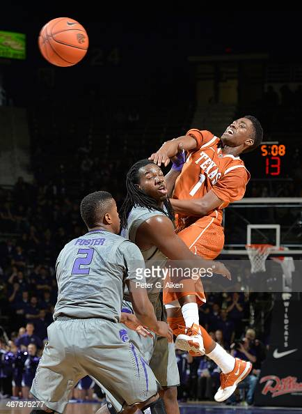 Guard Isaiah Taylor of the Texas Longhorns makes a pass against forward DJ Johnson of the Kansas State Wildcats during the first half on February 8...